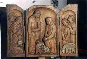 The wooden nativity scene.